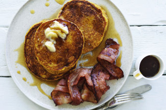 Pumpkin spice pancakes with bacon and maple syrup.